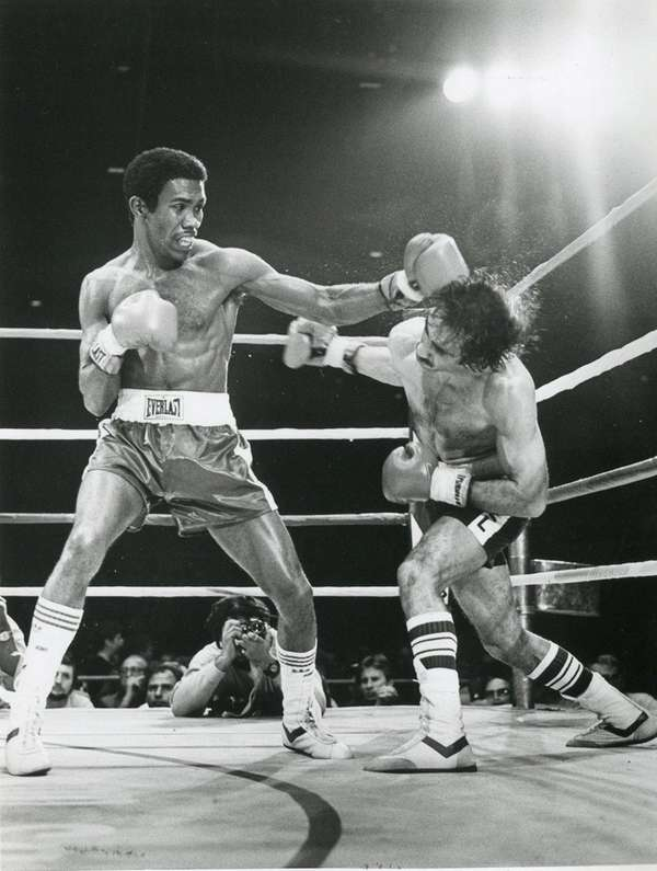 Howard Davis, left, battles Angel Cruz at the