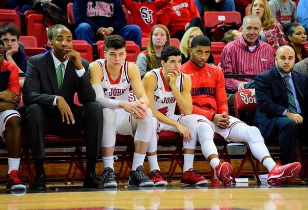 St. John's bench reacts as their team is