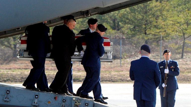 The coffin of Staff Sgt. Louis Bonacasa is