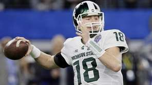 Michigan State quarterback Connor Cook passes the ball