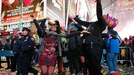 Revelers dance after the ball drop during New