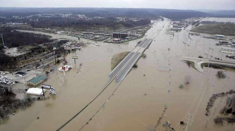 In this aerial photo, flood water covers Interstate