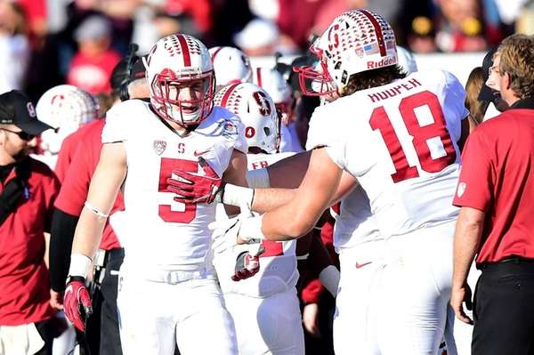 Stanford's Christian McCaffrey, left, celebrates his second touchdown