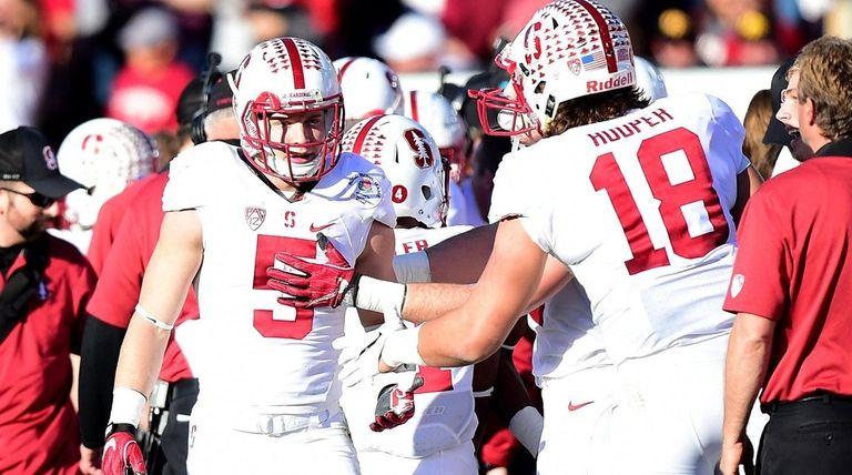 Stanford's Christian McCaffrey, left, celebrates his second touchdown