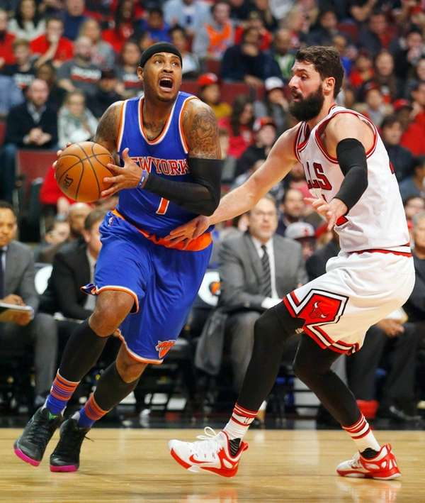 New York Knicks forward Carmelo Anthony is guarded