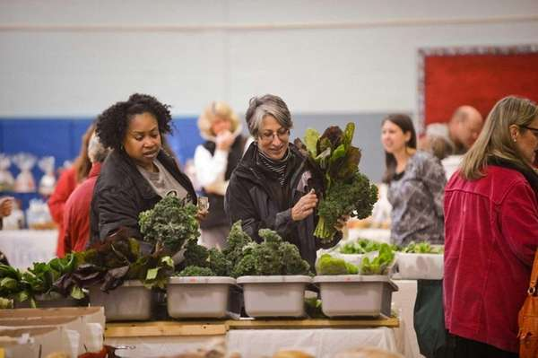 Customers shop at the winter farmers market at