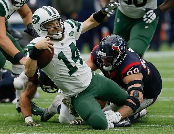 Ryan Fitzpatrick is sacked by Texans' J.J. Watt