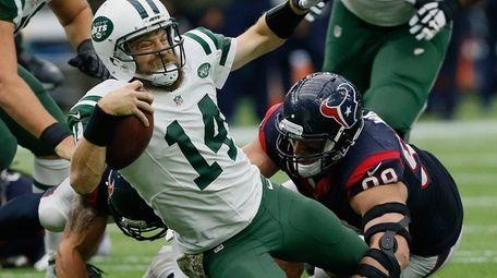 Ryan Fitzpatrick is sacked by Texans' J.J. Watt