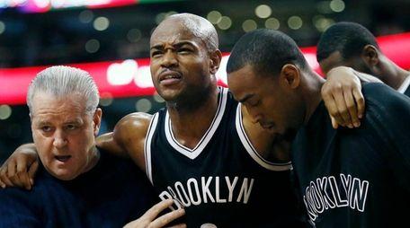 Nets' Jarrett Jack is helped off the court