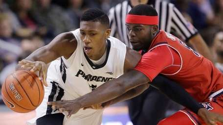 Providence guard Kris Dunn (3) and St. John's