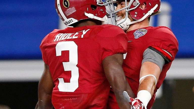 Alabama quarterback Jake Coker celebrates with wide receiver