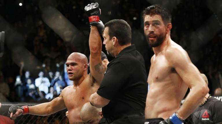 Robbie Lawler, left, celebrates after defeating Carlos Condit