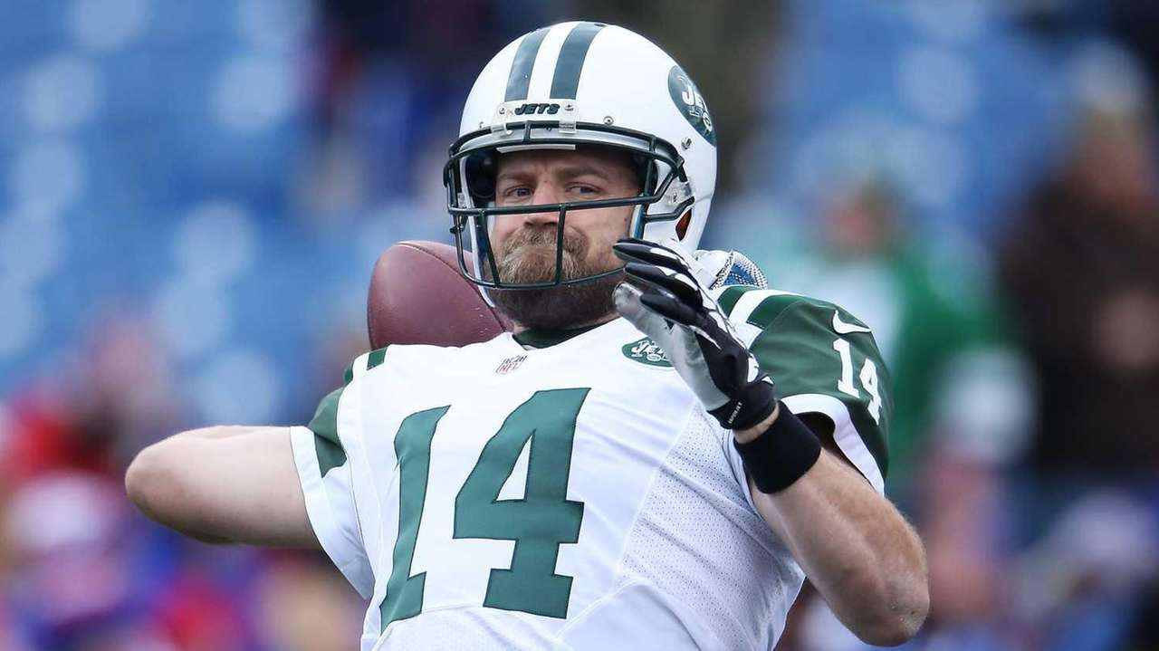 Ryan Fitzpatrick of the New York Jets warms