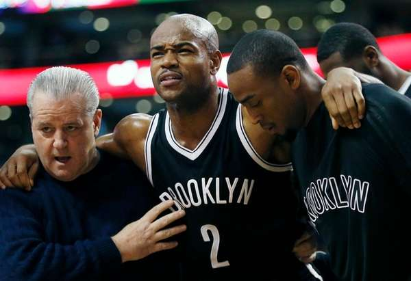 Jarrett Jack is helped off the court after