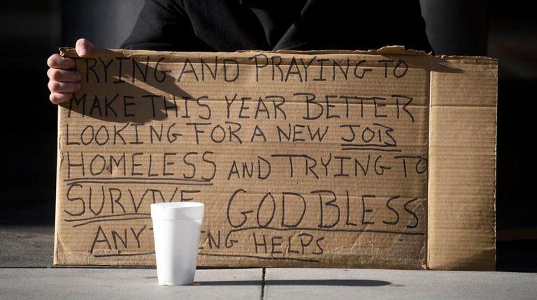 A man who said he is homeless holds