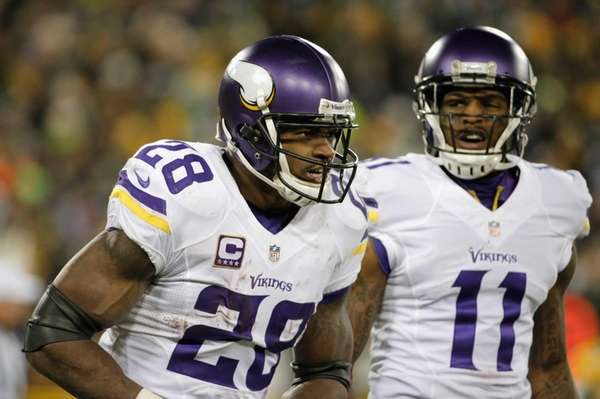 Adrian Peterson of the Minnesota Vikings reacts after