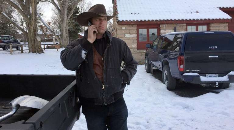 Ryan Bundy talks on the phone at