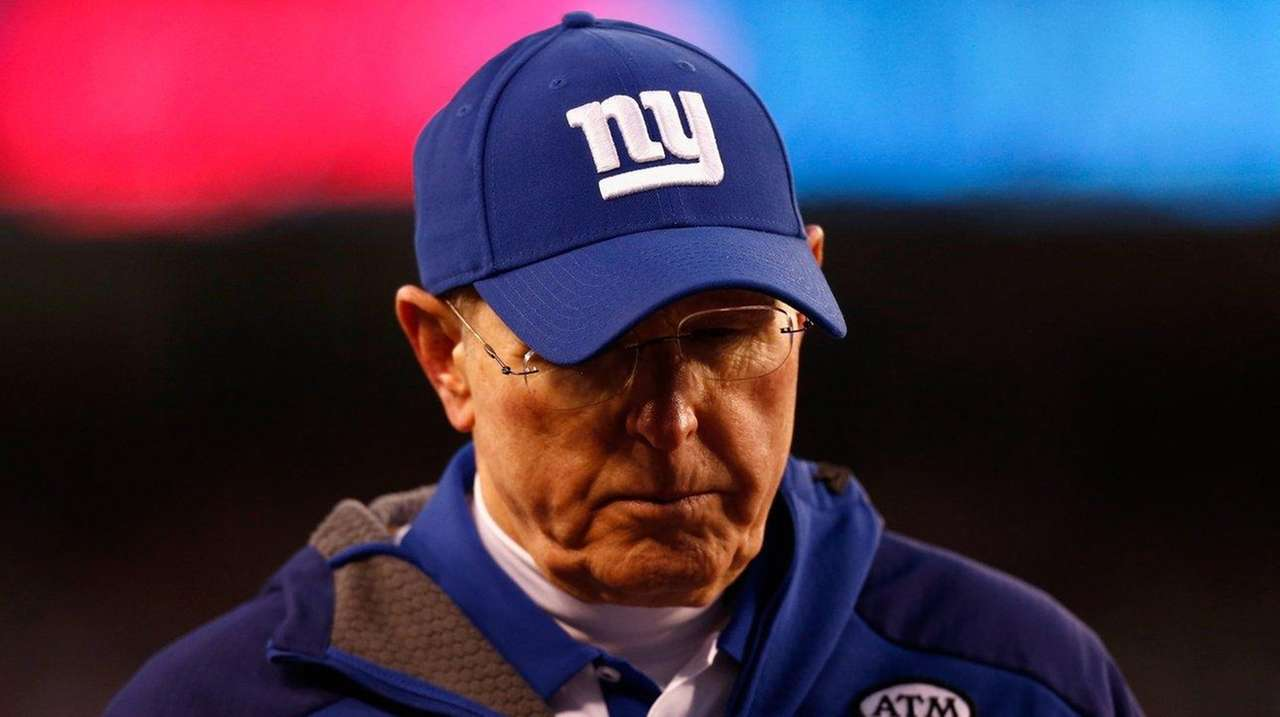 New York Giants head coach Tom Coughlin walks