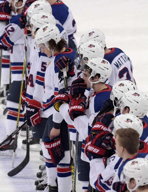 USA players react after the 2016 IIHF World