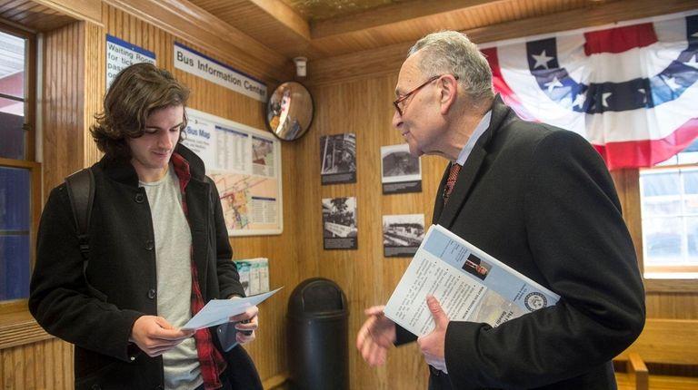 Sen. Chuck Schumer explains to a passenger how