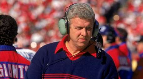New York Giants coach Bill Parcells walks on