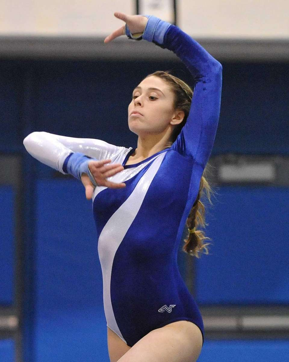 Dakota Ejnes of Long Beach performs her floor