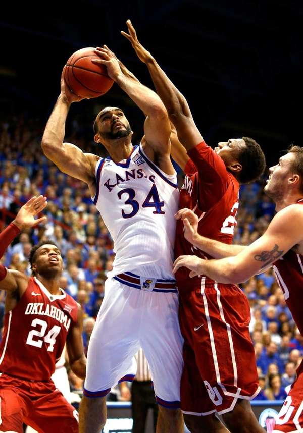 Perry Ellis of the Kansas Jayhawks shoots as