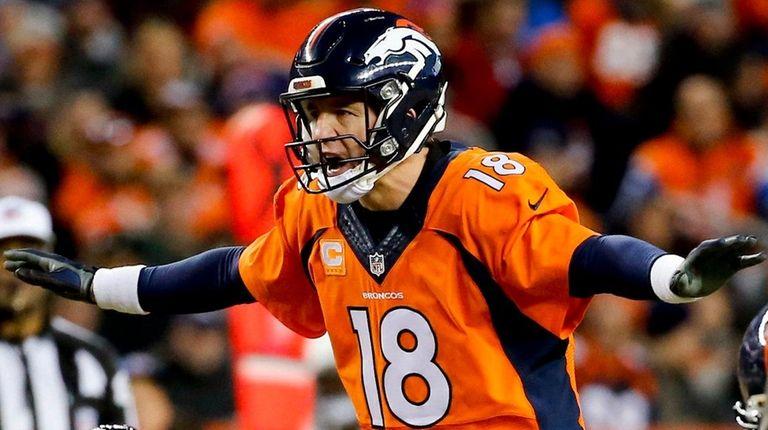 Denver Broncos quarterback Peyton Manning yells to