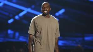 Kanye West accepts the Video Vanguard Award at