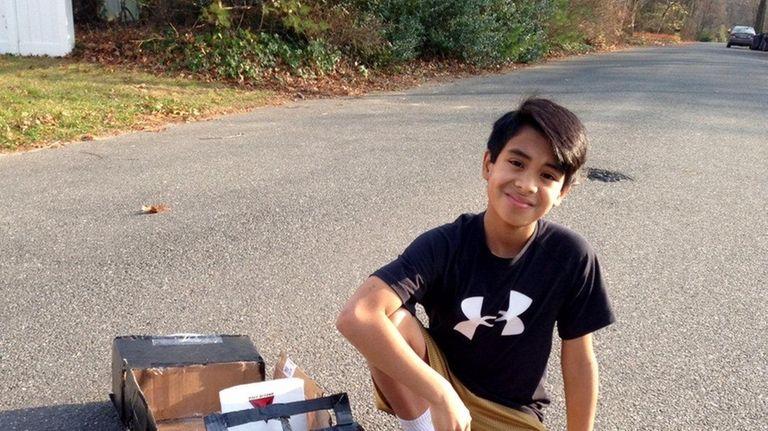 Kidsday reporter Ryan Sanders and the homemade car