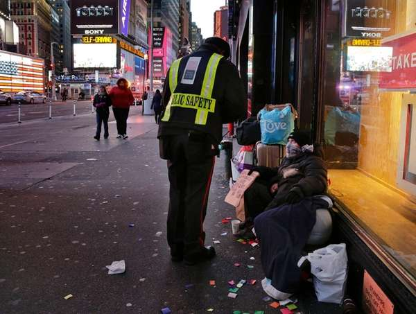 A public safety officer talks to a homeless