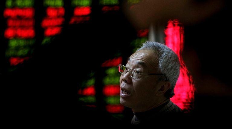 An investor in a brokerage house in Beijing,