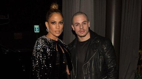 Jennifer Lopez and Casper Smart attend the American