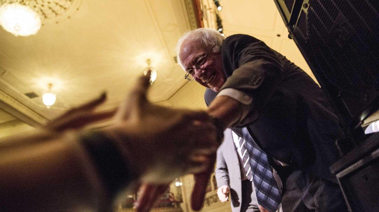 Democratic presidential candidate Sen. Bernie Sanders shakes hands