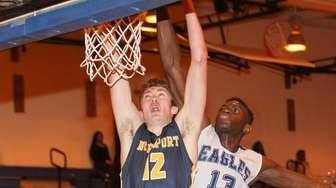 Northport's Lukas Jarrett (12) puts one up while