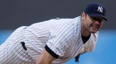New York Yankees pitcher Roger Clemens delivers against