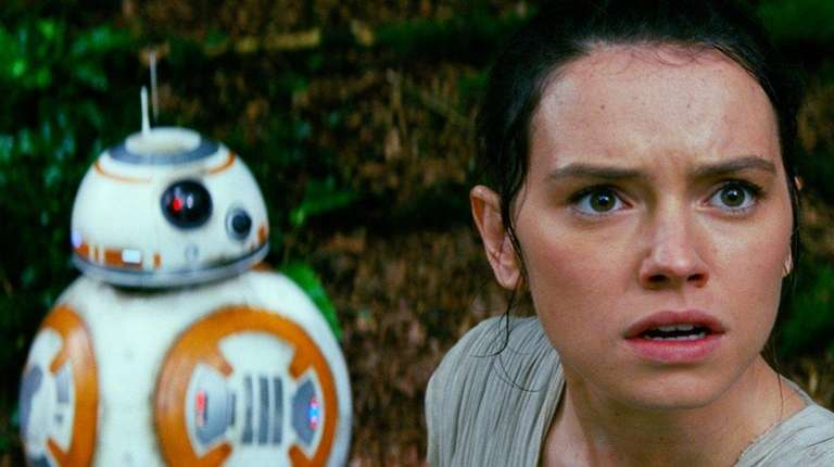 Actress Daisy Ridley as Rey, and BB-8 appear
