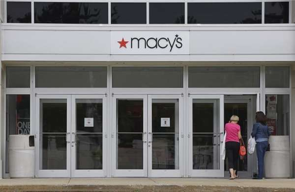 Shoppers walk into a Macy's department store at