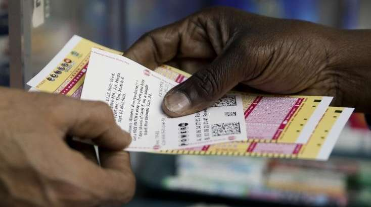 A person buys Powerball lottery tickets from a