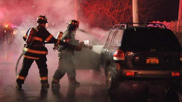 Firefighters battle a vehicle fire Thursday morning, Jan.