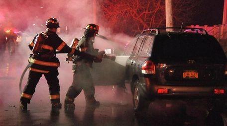 Firefighters battle a vehicle fire Thursday morning, Jan.