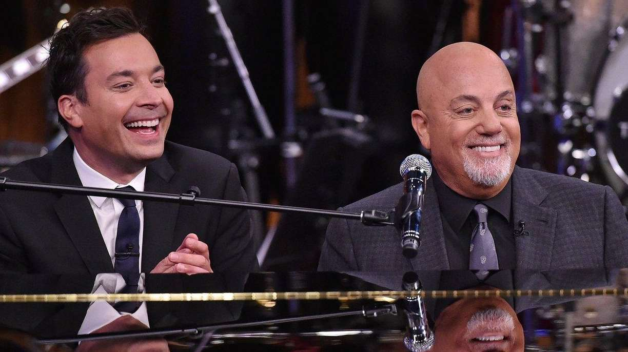 Billy Joel, right, and Jimmy Fallon perform