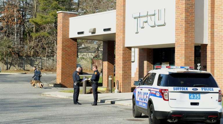 Suffolk County police investigate the robbery Thursday, Jan.