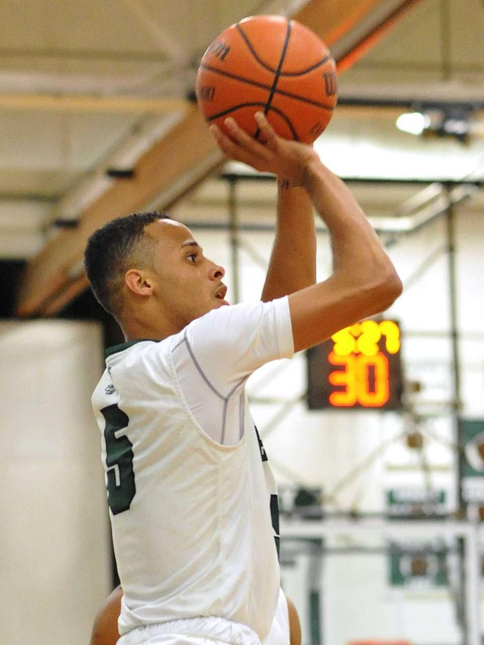 Michael Almonacy of Brentwood shoots a jumper during