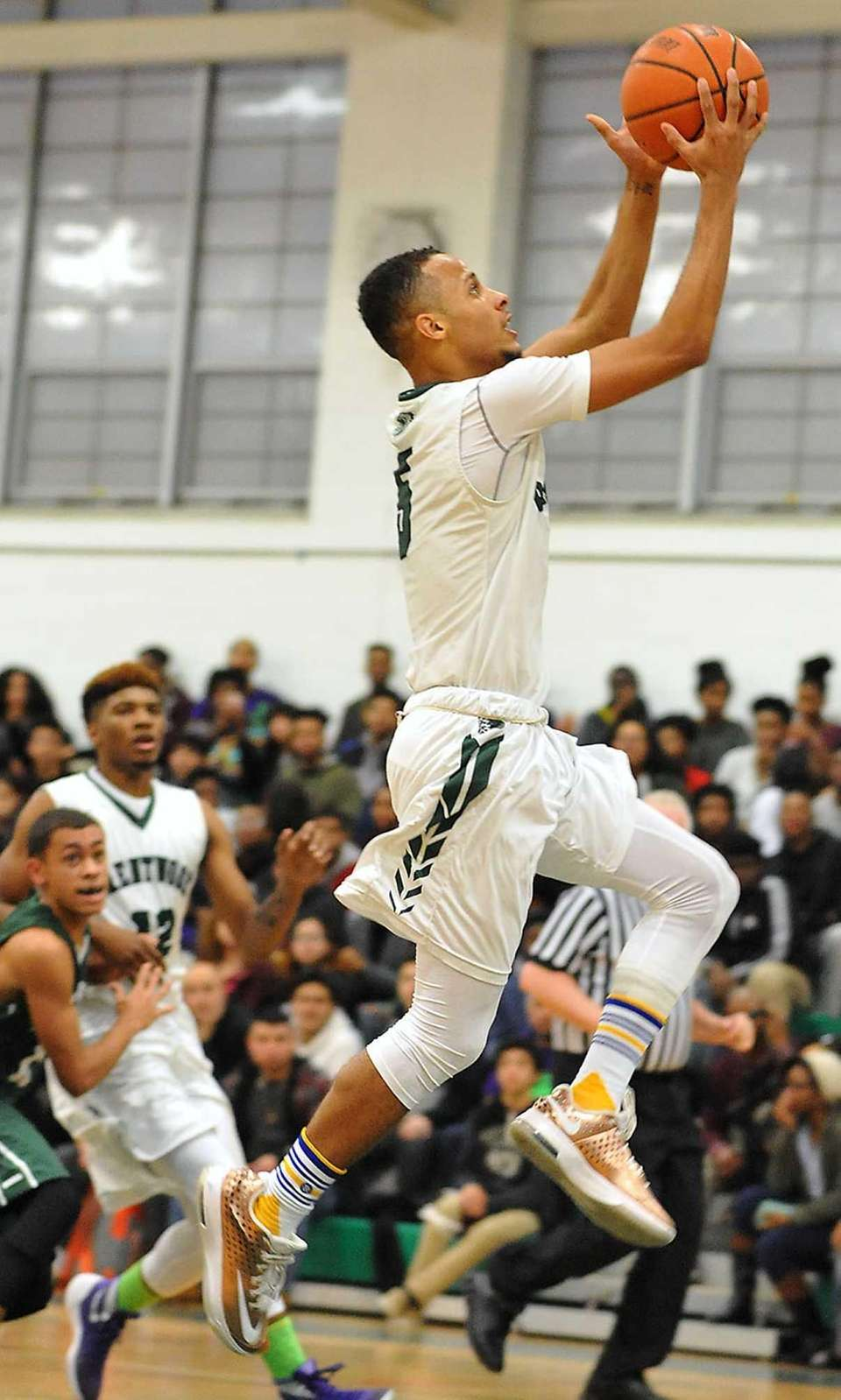 Michael Almonacy of Brentwood drives to the hoop