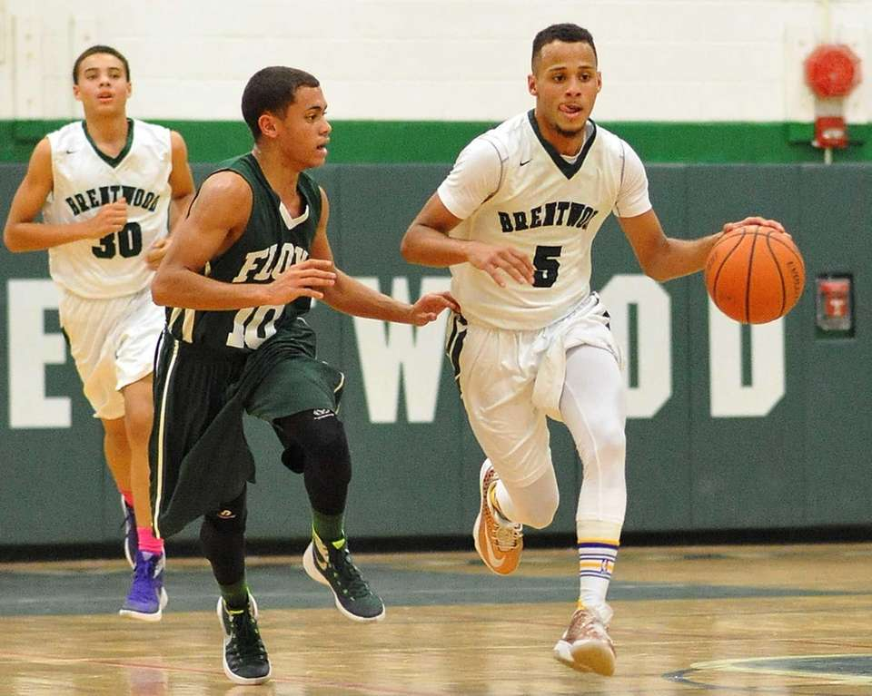 Michael Almonacy of Brentwood, right, dribbles upcourt under