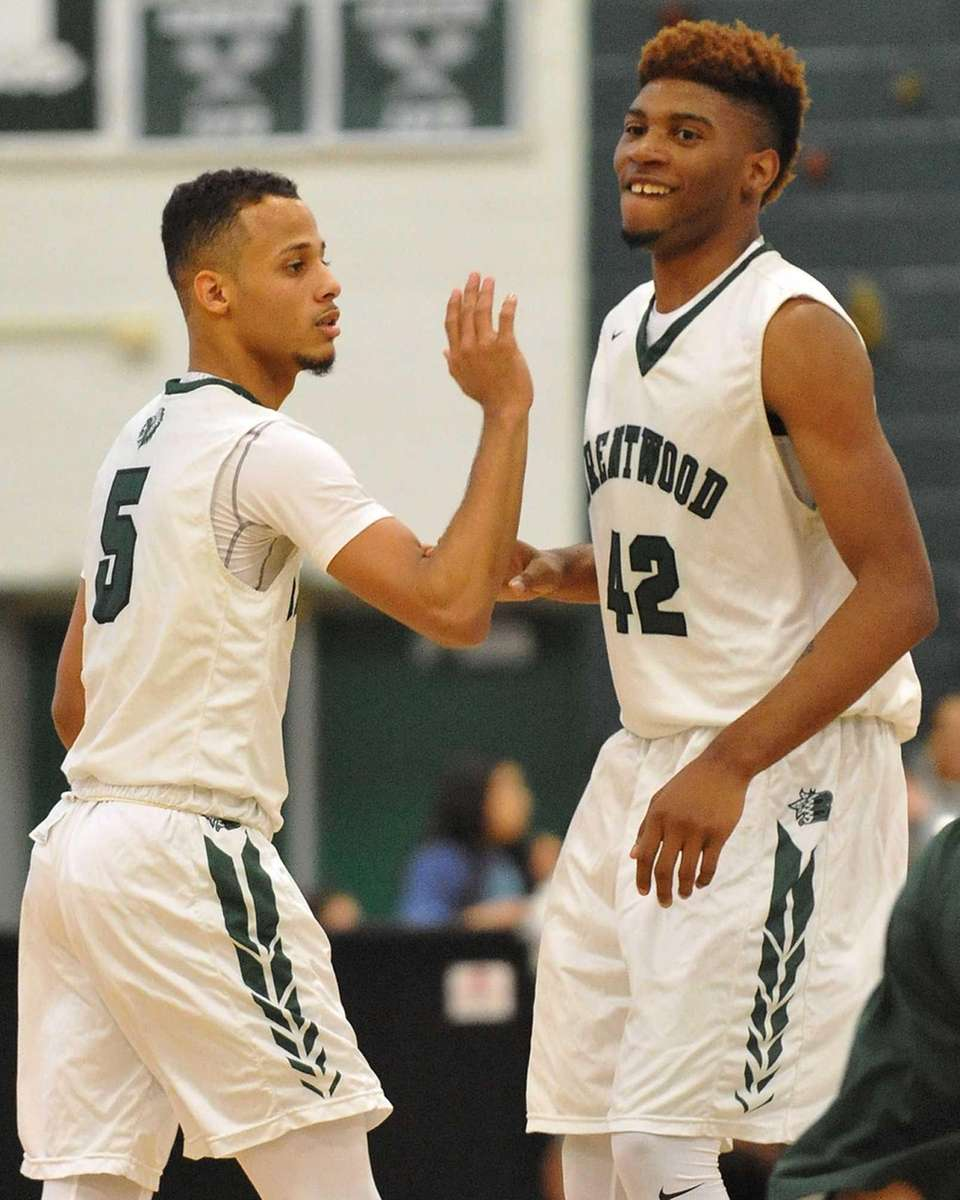 Michael Almonacy of Brentwood, left, and teammate Jamel