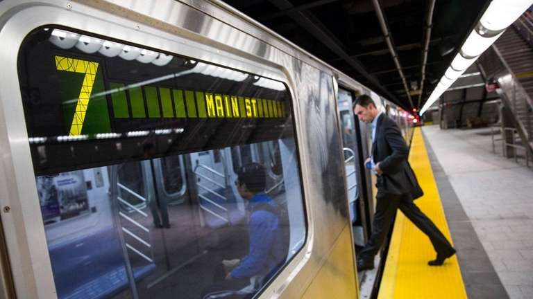 A commuter gets on the No. 7 train