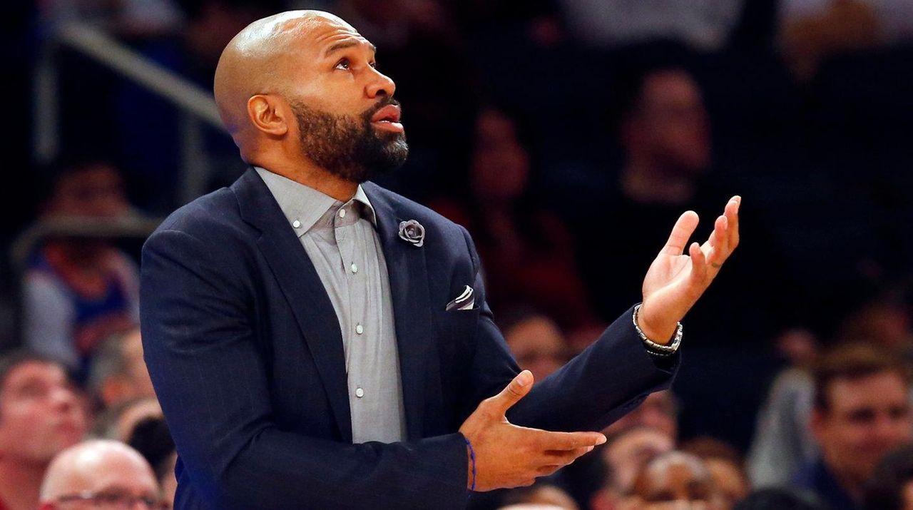 New York Knicks coach Derek Fisher looks on