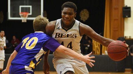 Bridgehampton's Josh Lamison drives to the basket defended